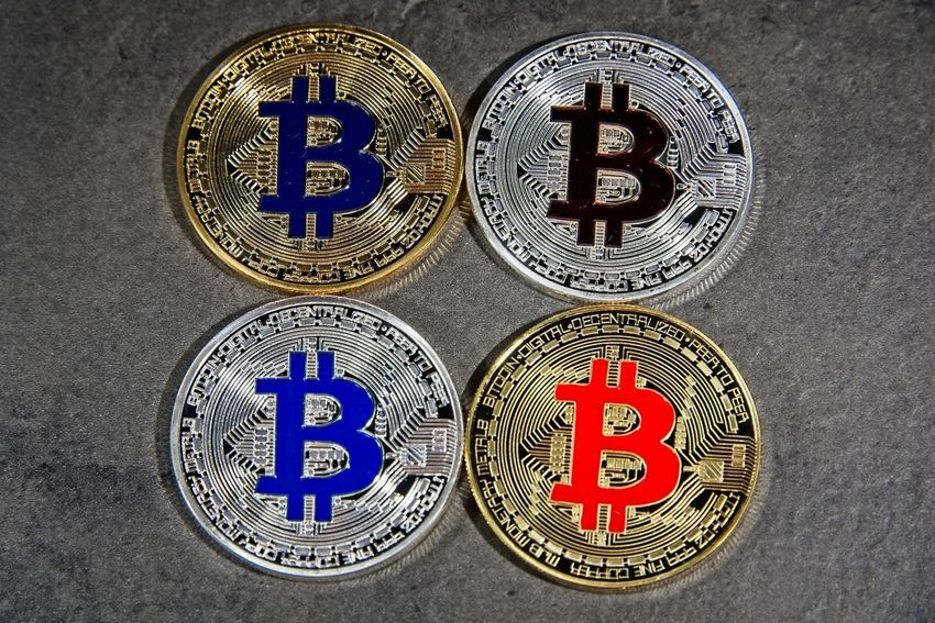 Shining gold and silver metal BTC Bitcoin coins on grey background BTC Gold Taxi Virtual Reality Bitcoin Blockchain Coin Crypto Cryptocurrency Cryptography Digital Eth Ether Ethereum Exchange Finance Metal Silver