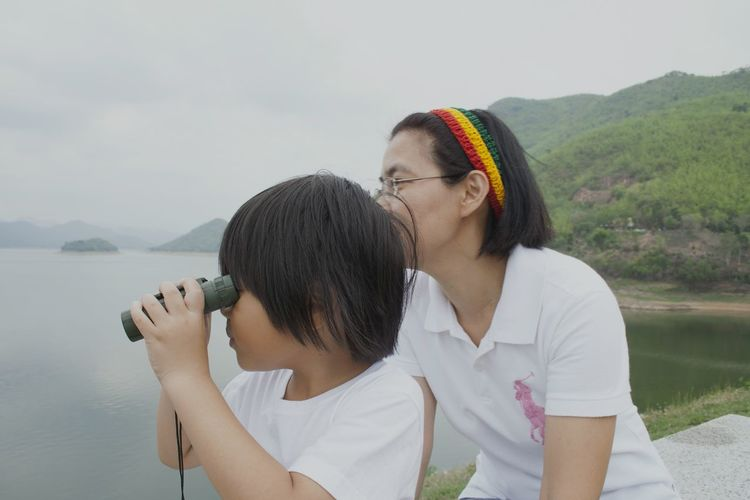 Kaeng Krachan Dam Mother And Son Binoculars Two People Women Adult Heterosexual Couple Adults Only Couple - Relationship Togetherness Water Love People Day Outdoors Mountain Vacations Cheerful