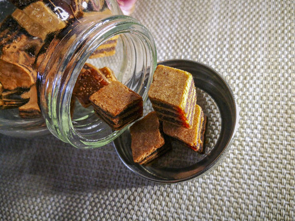 Closeup and selective focus a Sarawak Layer Cake or local called Kek Lapis with minimal lighting and flare serve on the top of table. Sarawakmalaysia Layer Cakes Food And Drink Food Indoors  Jar Container No People Glass - Material Table SLICE Freshness High Angle View Healthy Eating Wellbeing Bread Close-up Still Life Directly Above Tablecloth Sweet Food Toasted Bread Breakfast Snack