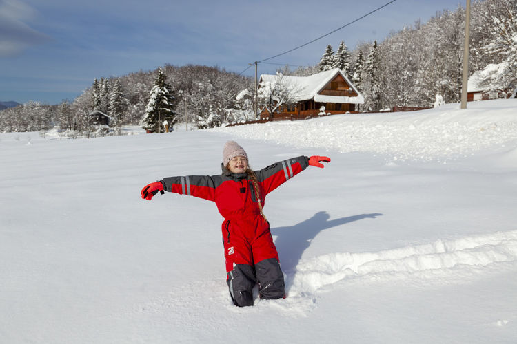 Rear view of child on snow field