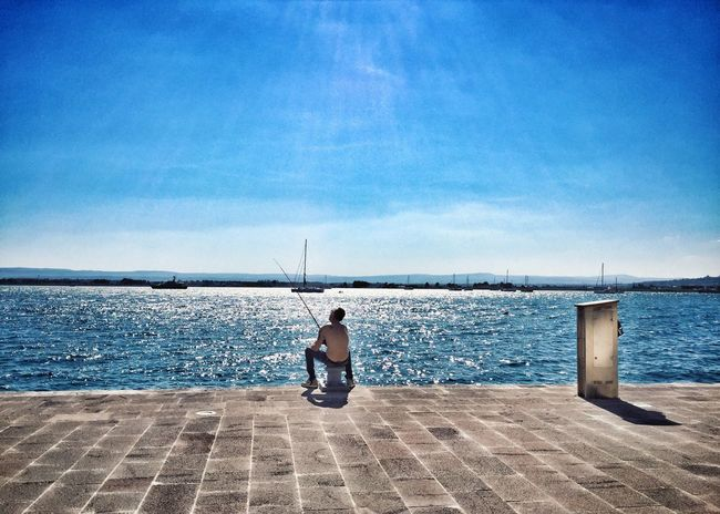Hello World Relaxing Taking Photos Enjoying Life Streetphotography Street Photography Street People Watching People Photography Fishing Fisherman Sicily Siciliabedda Tranquility Sicilia Ortigia Hello World Enjoying The View Sea Sea And Sky Sea View Enjoying The Sun Marina - Ortigia