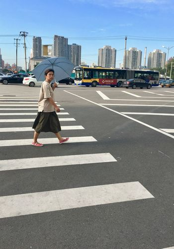 Full length of woman on road in city