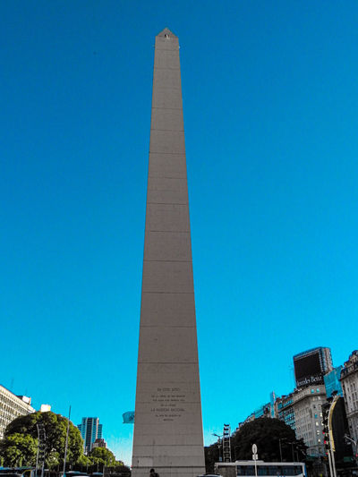 Low angle view of monument against blue sky