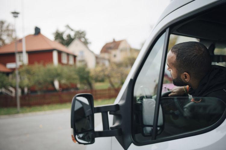 Rear view of boy in car