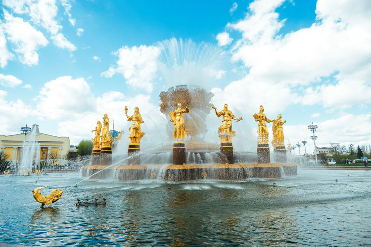 Statue of fountain against cloudy sky
