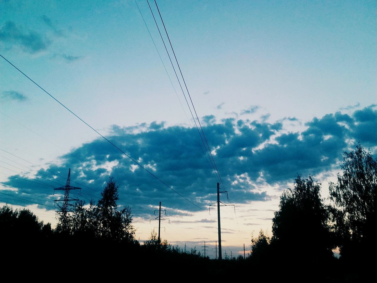 cable, power line, electricity pylon, electricity, power supply, fuel and power generation, connection, sky, silhouette, tree, low angle view, technology, electricity tower, cloud - sky, no people, nature, day, telephone line, outdoors, beauty in nature, vapor trail