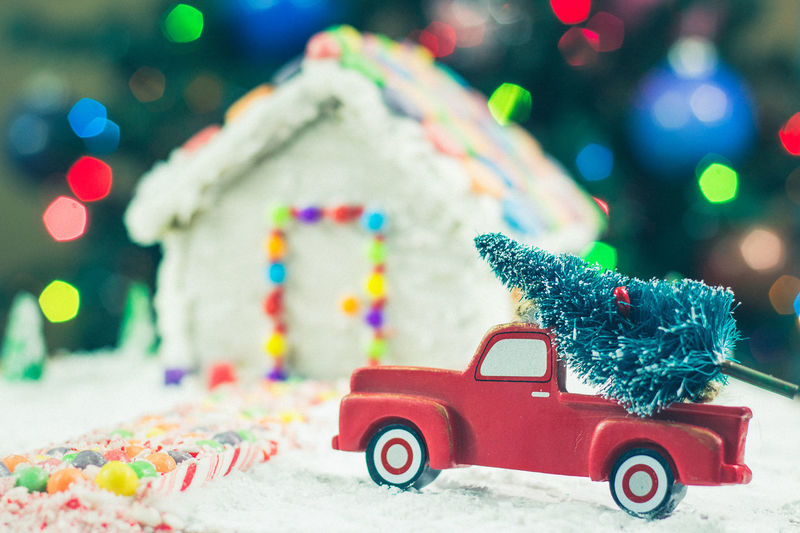 Close-up of gingerbread house with christmas decorations at home