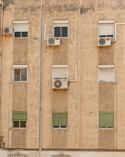 Air Conditioner Architecture Backgrounds Building Building Exterior Façade No People Photographer Arturo Macias Poor Suburban Repetition Residential Building Residential Structure Suburban Suburban Landscape Window