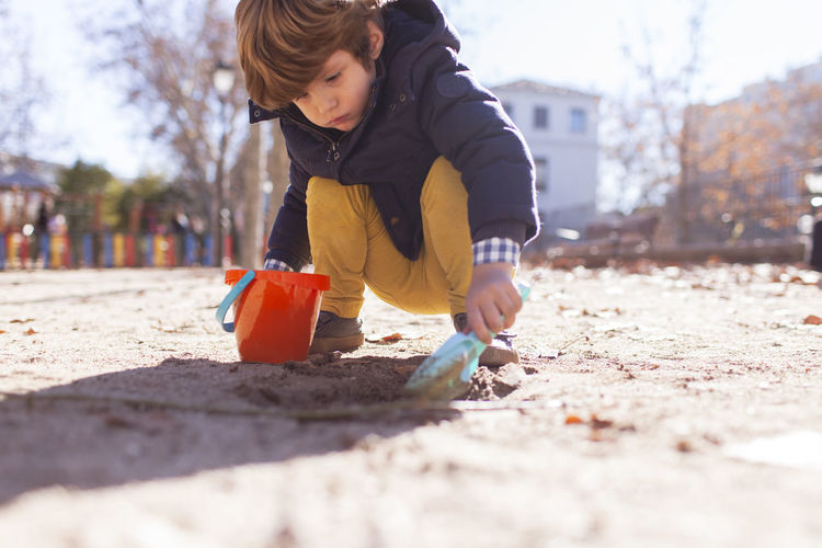 Boy playing on sand