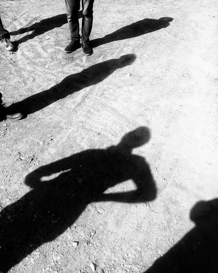 Shadow Real People Focus On Shadow Sunlight Human Body Part Leisure Activity Lifestyles High Angle View Day Long Shadow - Shadow Outdoors Togetherness Enjoy The New Normal Road Trip Peace People Bnw Bnw_friday_eyeemchallenge