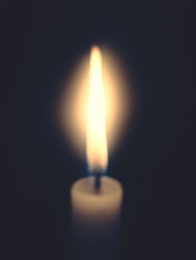 Black Background Illuminated Flame Heat - Temperature Burning Candle Glowing Close-up