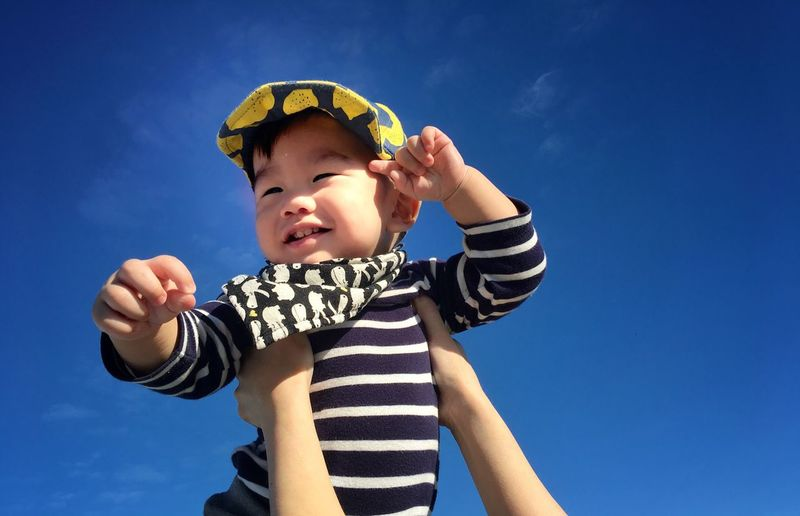 Boys Low Angle View Childhood Real People Sky Gesturing One Person Lifestyles Cap Standing One Boy Only Human Hand Taiwan Cute Outdoors Moment Relaxing Moments Portrait Love