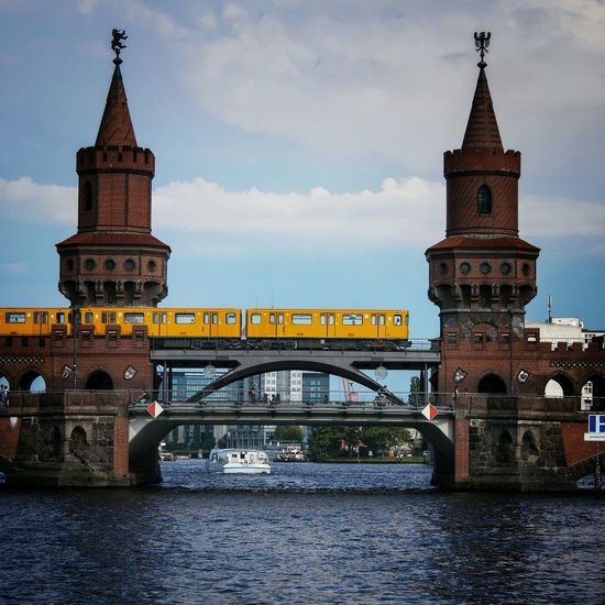 One thing almost everybody in Berlin has shot is the Oberbaumbrücke with a train goin by. A famous Bridge between Kreuzberg and Friedrichshain. Spree Cityscapes Historical Sights Riverside Sbahn