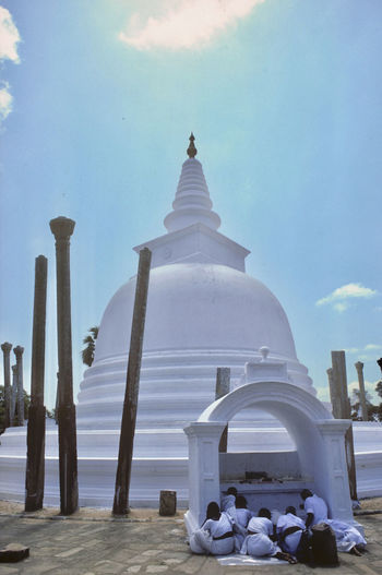 Prayer Anuradhapura Sri Lanka Architecture Building Exterior Built Structure Dagoba Day Holy Lifestyles Outdoors Prayers Praying Real People Religion Sky Spirituality Temple Tourism Travel Destinations White Color Women