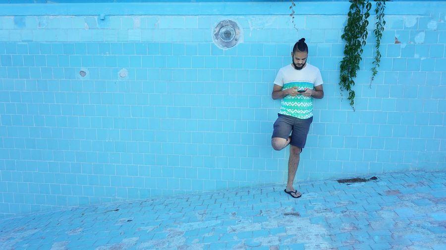Full length of man swimming in pool