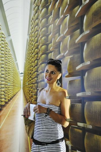 One Woman Only Indoors  Fashion One Young Woman Only Beautiful Woman Portrait Young Women Cheese Seasoned Cheese Cantina Smiley Smile Grana Padano Parmiggiano Food Italian Food Italian Food Mark EyeEmNewHere Made In Italy Italian Made Italian Food Photography Parmigiano Reggiano Parmigianoreggiano Parmigiano Cheese