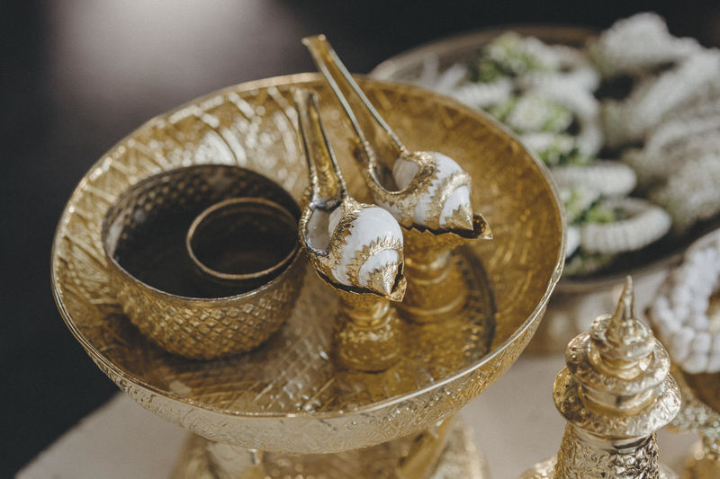 Conch watering in Thai wedding ceremony Conch Watering Animal Shell Antique Art And Craft Close-up Creativity Focus On Foreground Gold Gold Colored Indoors  Luxury Metal No People Ornate Personal Accessory Selective Focus Shell Silver Colored Still Life Table Thai Wedding Wealth Wedding Ceremony-thai Style