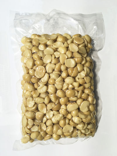 Macadamia Nuts in vacuum plastic bag isolated on white background Diet Isolated Nuts Plastic Bag Snack Abundance Bean Close-up Food Food And Drink Freshness Healthy Eating Large Group Of Objects Macadamia Nuts Organic Food Package Packing Peeled Raw Food Snack Still Life Vacuum Vacuum Plastic Bag Wellbeing White Background