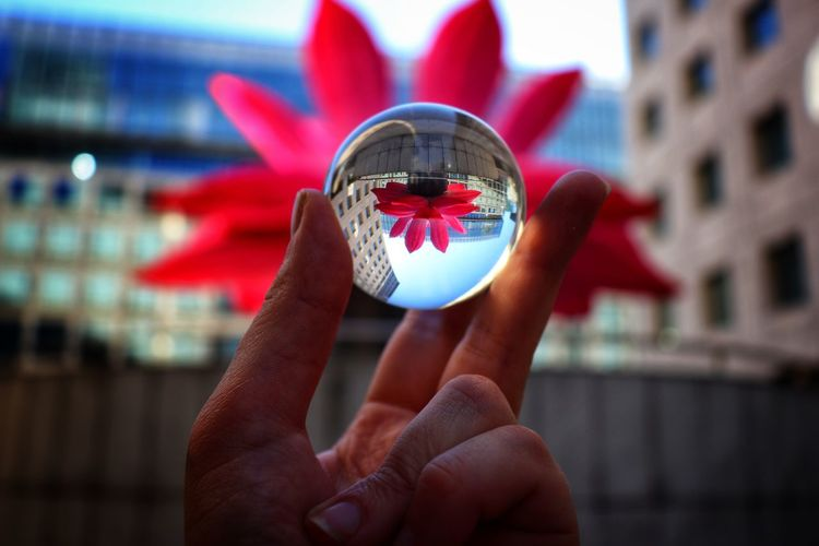 Close-up of person holding glassball