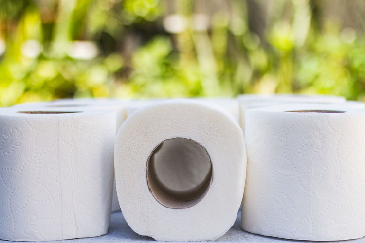 Close-up of white stack on table