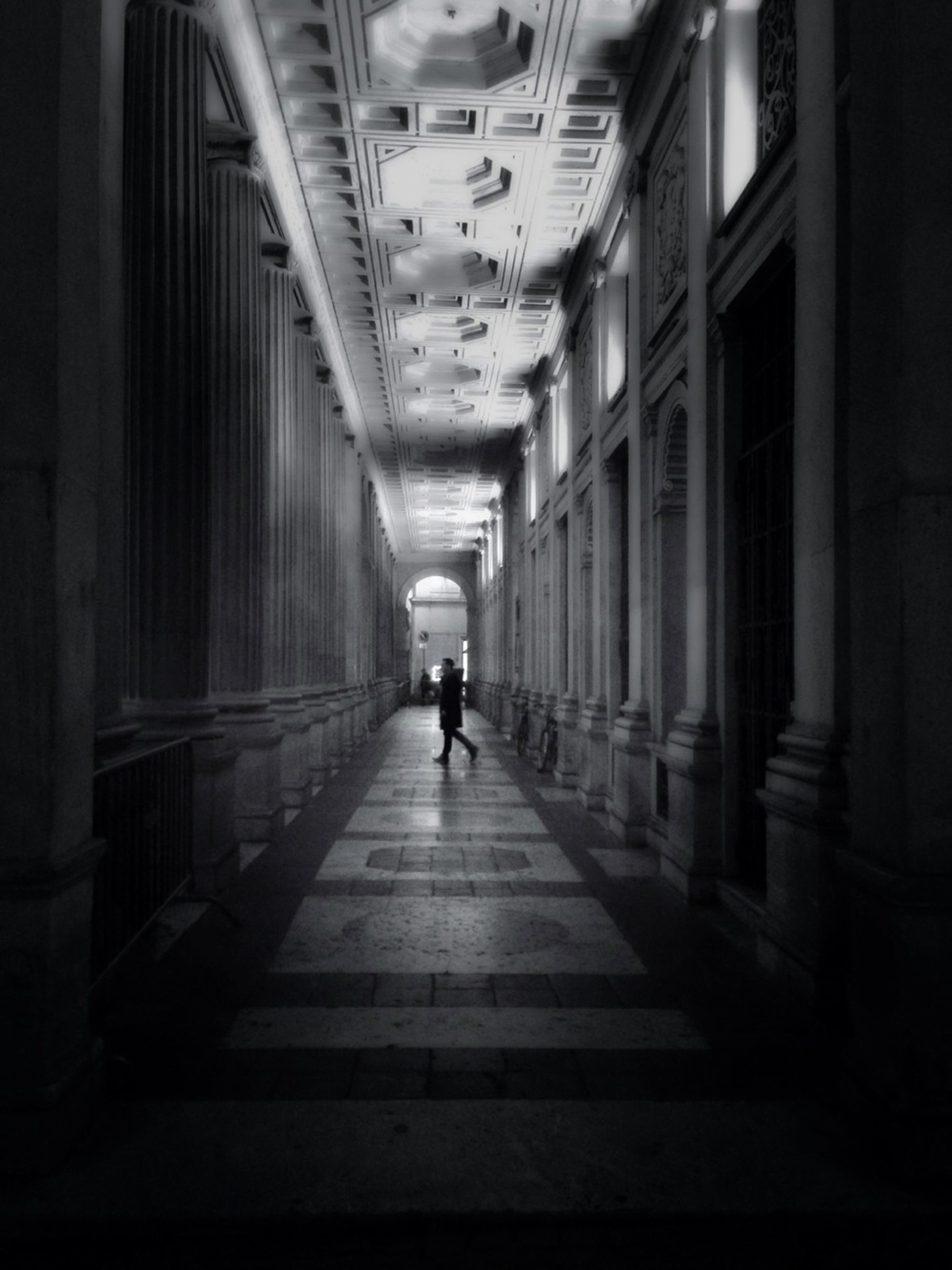indoors, walking, architecture, full length, men, the way forward, built structure, rear view, lifestyles, person, diminishing perspective, city life, leisure activity, corridor, transportation, building, city