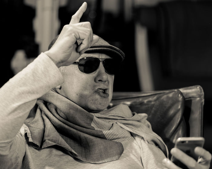 The Secret Life Of Don Giancarlo (Series of Selfies; Hat, Cap, Scarf, Eyeglasses, sunglasses, Mobile Phone, three point lighting, Pentax K-1 on tripod remote control via Smartphone App) Acting Hat Old Man Sitting Storytelling Acting Crazy Day Expressions Feelings Focus On Foreground One Person Outdoors People Scarf Selfie Series Sunglass  Sunglasses
