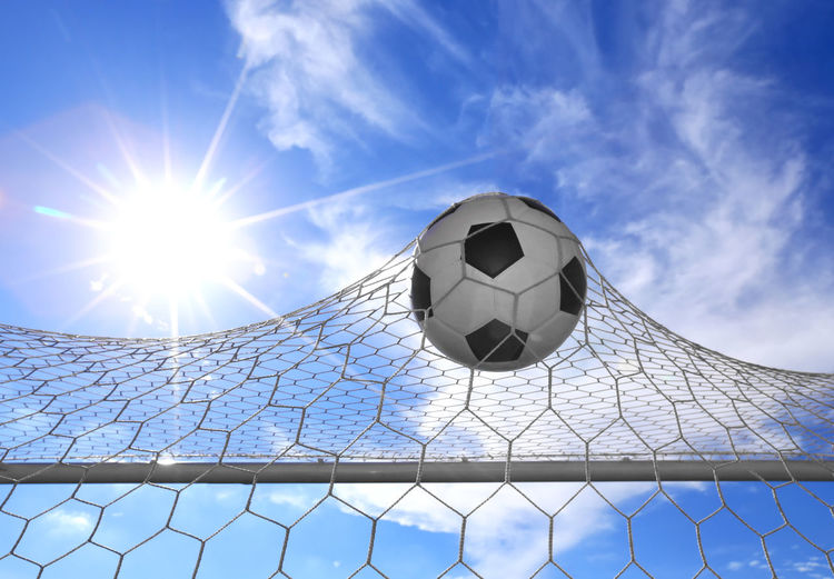 Low angle view of soccer ball on sunny day