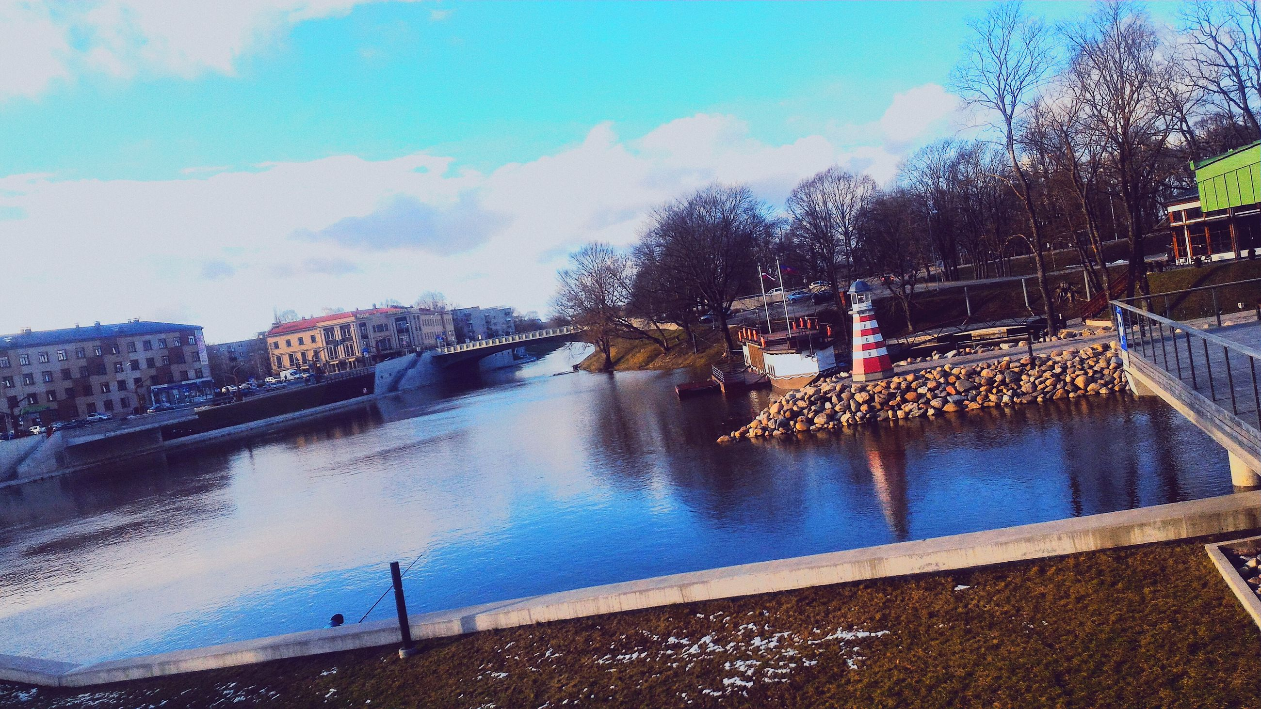 water, tree, built structure, architecture, reflection, railing, building exterior, bridge - man made structure, river, sky, fountain, connection, city, canal, day, outdoors, nature, blue, bare tree, waterfront