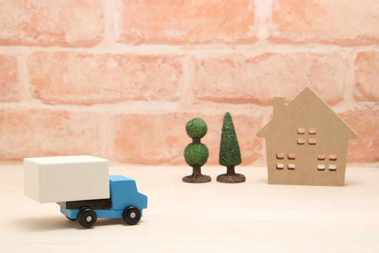 Automobile Business Copy Space Delivery Distribution Home Logistics Transportation Work Car Cargo Carry Courier Freight Transportation House Luggage Mail Order Miniature No People Pick Up Truck Studio Shot Town Toy Truck Vehicle