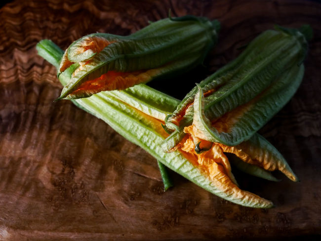 Courgette Flower Close-up Directly Above Focus On Foreground Food Food And Drink Freshness Fruit Green Color Healthy Eating High Angle View Indoors  Leaf No People Plant Part Raw Food Still Life Table Vegetable Wellbeing Wood - Material