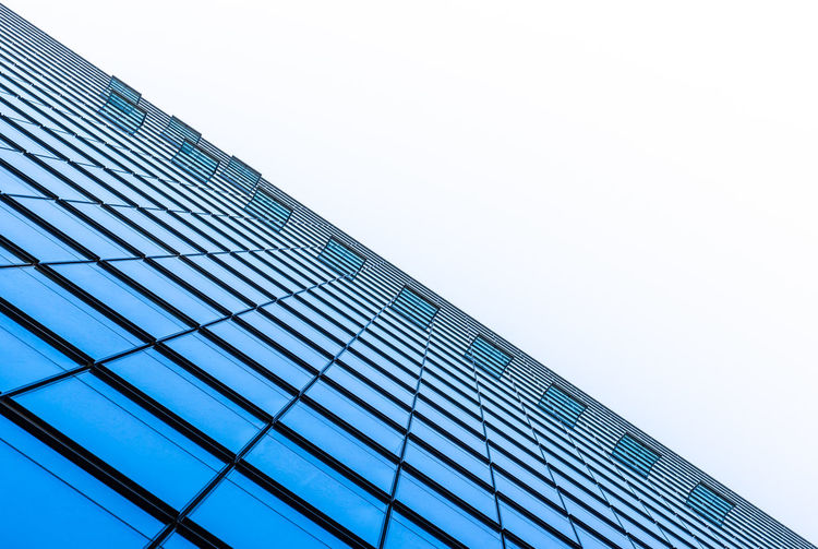 Financial District  Business Finance And Industry Business Downtown District Futuristic Abstract Blue Lines Lines And Shapes Technology Krull&Krull Architecture Krull&Krull Images Built Structure Building Exterior Architecture Sky Low Angle View Building Modern Office Office Building Exterior City No People Tall - High Clear Sky Glass - Material Day Nature Skyscraper Copy Space Reflection Pattern Glass Directly Below