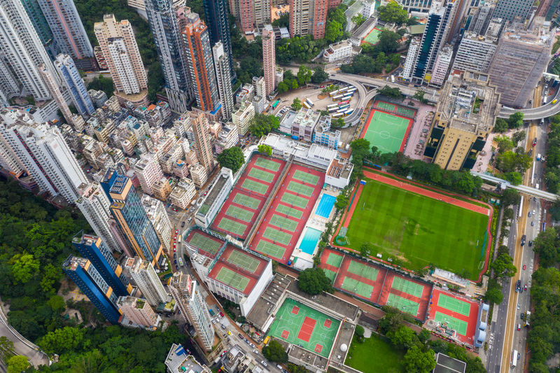 Hong Kong Hong Kong Aerial View Causeway Bay Victoria Park Tennis Court Recreation  Playground Building Skyline Cityscape Urban High Life Skyscraper Office Downtown Panoramic Landmark Dusk Town District Top Fly Drone  Over Above Down Top Down Bird Eye Hk Hong Kong City