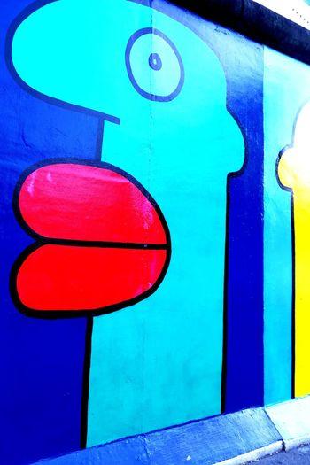 Neon Life Multi Colored Close-up No People Day Outdoors Culture Kultobjekt Berlin Wall Berlin Photography Historic Colourful Eye Blue Yellow Streetphotography Street German History East Germany West Germany Divided Graffiti Wall Graffitiworldwide Graffitiart Berlin Love Discover Berlin EyeEm Ready   #FREIHEITBERLIN
