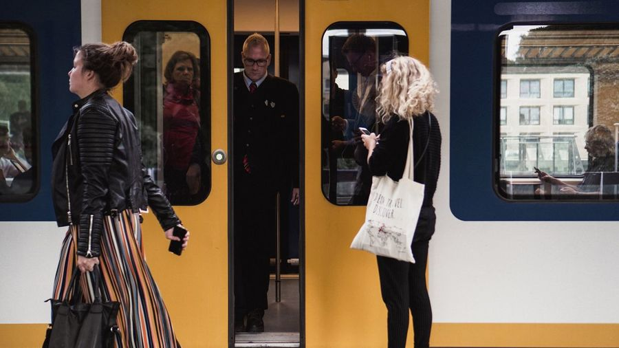 Daily life in Amsterdam. Station EyeEm EyeEmBestPics EyeEm Best Shots EyeEmNewHere Train Station Train Men Adult Women Group Of People People Three Quarter Length Reflection Casual Clothing Real People Building Exterior Architecture City Day Mid Adult Lifestyles