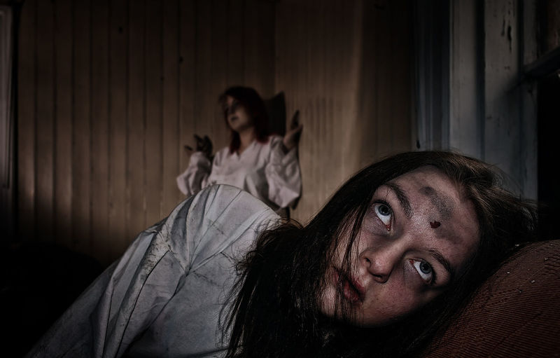 Fear Emotion Indoors  Adult Furniture Portrait Horror Women Spooky Bed Young Adult Looking At Camera People Headshot Terrified Hair Bedroom Two People Looking Depression - Sadness Hairstyle Aggression  Dark