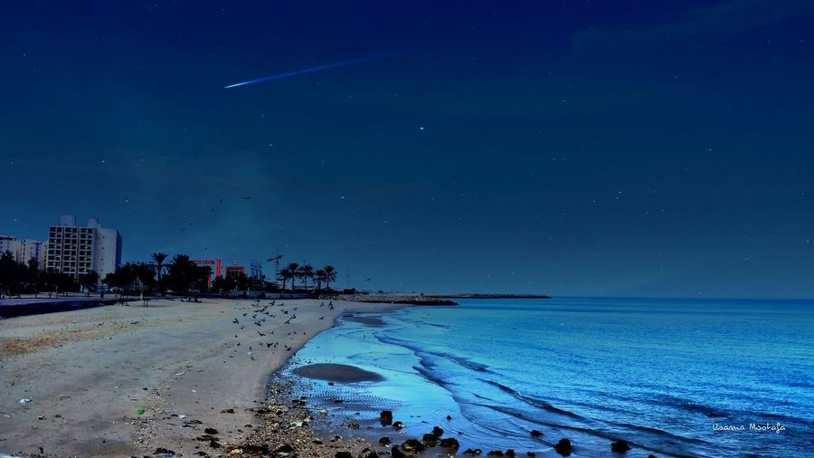 EyeEm Selects Beach Sea Night Sky Blue Landscape Sand Horizon Over Water Tranquility Water Outdoors No People Nature Illuminated Scenics City Beauty In Nature Star - Space Beauty Clear Sky Connected By Travel EyeEmNewHere Be. Ready.