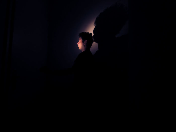 After dark Dark HUAWEI Photo Award: After Dark Light Adult Black Background Contemplation Copy Space Dark Emotion Indoors  Leisure Activity Lifestyles Men Nature Night People Real People Shadow Side View Silhouette Standing Two People Vampire Women Young Adult Capture Tomorrow