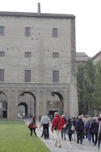 Group of people walking against building