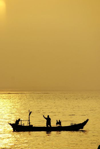 The Human Condition Snapshots Of Life My Country In A Photo Beautiful Sunlight Sunset Silhouettes Fishing Boat Golden Moment Taiwan Style Beautiful Nature Sunset
