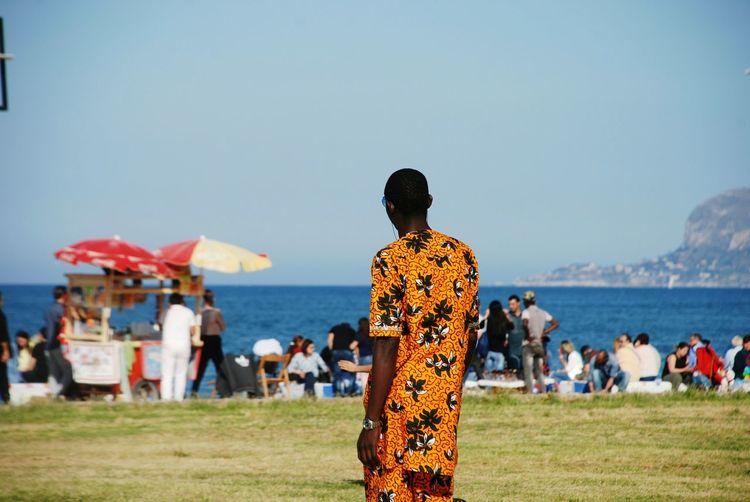 Man looking crowd at beach