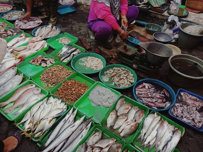 Low section of woman selling fish at market