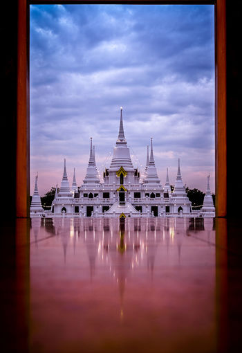 Asokaram Temple with scenic sky soft mirror on the chapel floor Asokaram Temple Sky Built Structure Architecture Reflection Cloud - Sky Travel Destinations Religion Building Exterior Travel Belief Water Spirituality Place Of Worship Nature Waterfront Tourism History No People The Past Outdoors Spire  Samutprakarn Thailand