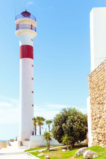 Tourism in spain. View of the lighthouse Beach Beauty In Nature Blue Blue Sky Cadiz Coastline Europe Holiday Lighthouse Mammal Mediterranean  Palm Tree Promenade Scenic Scenics Sea Seaside Sky Sunset Tourism Town Travel Vacations