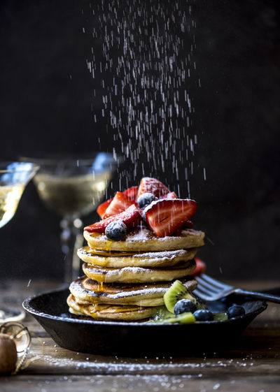 Close-up of pancakes stacked in plate