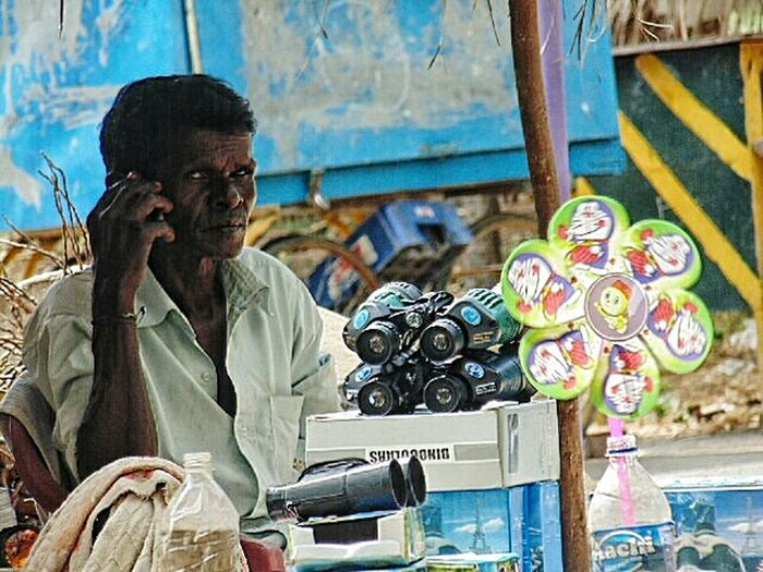 The Portraitist - 2016 EyeEm Awards The Street Photographer - 2016 EyeEm Awards The Photojournalist – 2016 EyeEm Awards Street Photography Portrait Of Innocence EyeEm Best Shots Close-up Photo Of The Day Shop Keeper Cellphone Unknown People Looking At Camera Looking At Things Selling On The Street