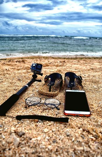 Beach Sand Technology Sea Wireless Technology Portable Information Device Mobile Phone Camera - Photographic Equipment No People Horizon Over Water Photographing Sky Communication Outdoors Wave Photography Themes Smart Phone Day Vacations Nature