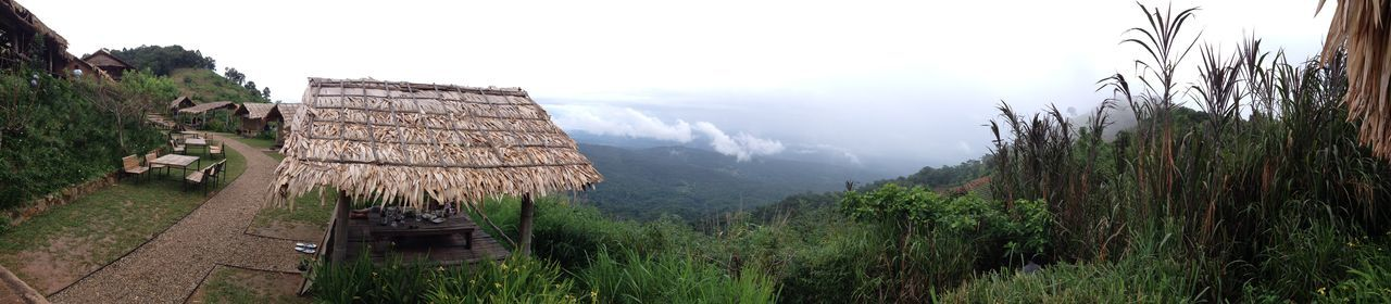 Scenery on Doi Moong during the rainy season in Chiang Mai, Thailand. Architecture Built Structure Day Environment Field Fog Grass Hut Land Landscape Mountain Nature No People Outdoors Panoramic Plant Scenics - Nature Sky Tranquility Tree