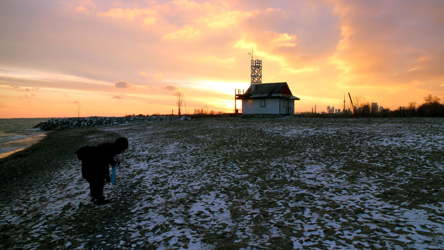 Photos taken in and around Toronto, New Years 2019. Winter Beach Sunset Sky Water Cloud - Sky Architecture Nature Built Structure Building Exterior Tower Scenics - Nature Orange Color Building Real People Outdoors Ontario, Canada Beaches Picking Stones
