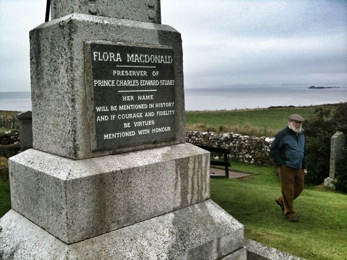 the grave of Flora MacDonald, who helped Bonnie Prince Charlie escape in 1746. She later moved to America but lost everything during the war of independence and returned to her home on Skye.