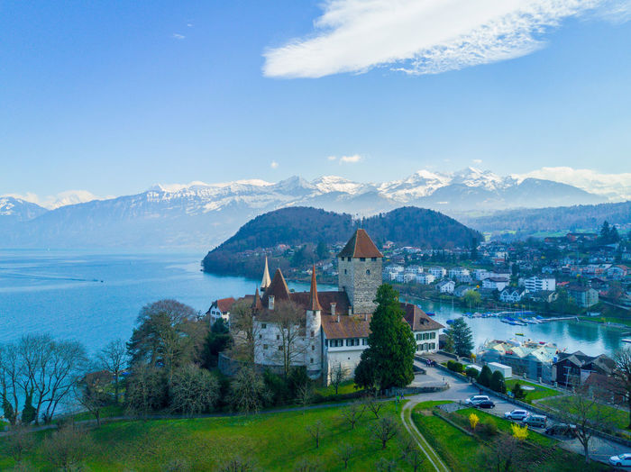Architecture Beauty In Nature Blue Building Exterior Built Structure Castle Day Grass History Landscape Mountain Mountain Range Nature No People Outdoors Place Of Worship Sky Spiez Switzerland Travel Travel Destinations Tree Water